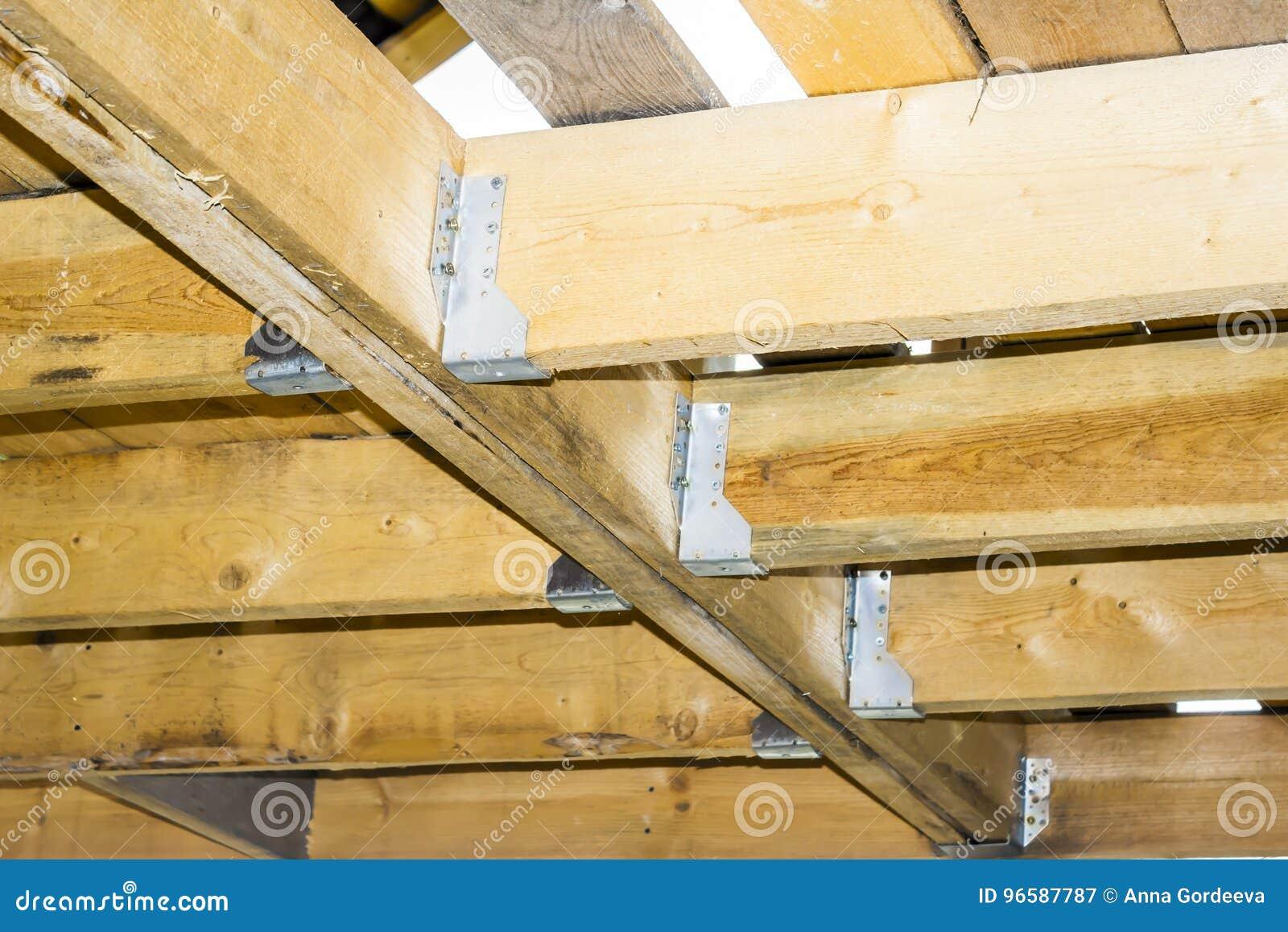 Ceiling beams - floors in a wooden frame house, metal fasteners