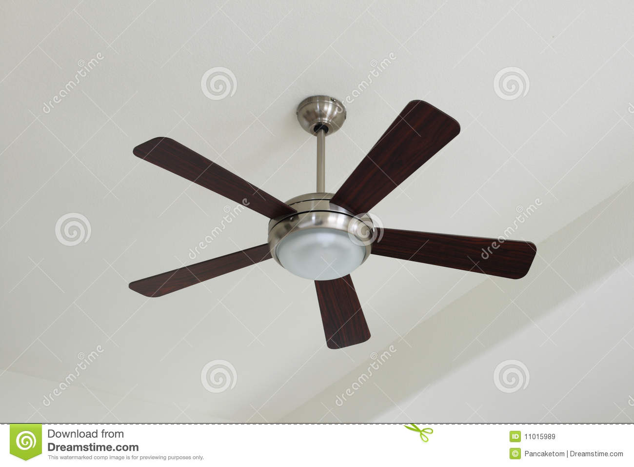 Silver and wood ceiling fan with a light on a white ceiling.