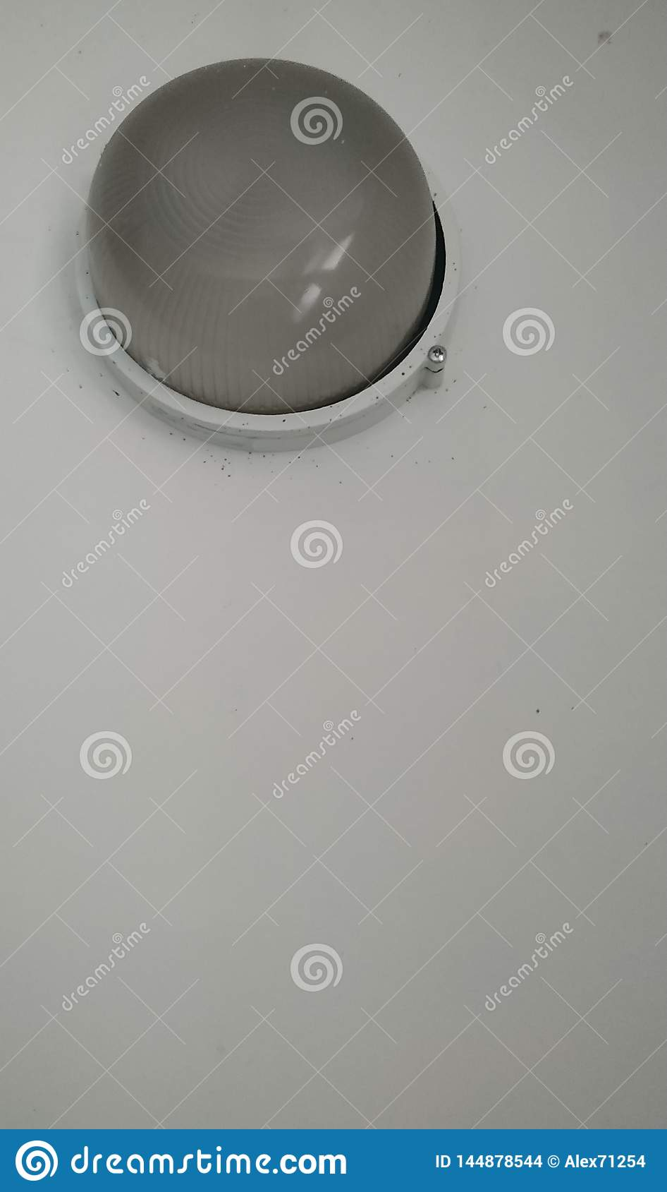 Ceiling lights on a white wall