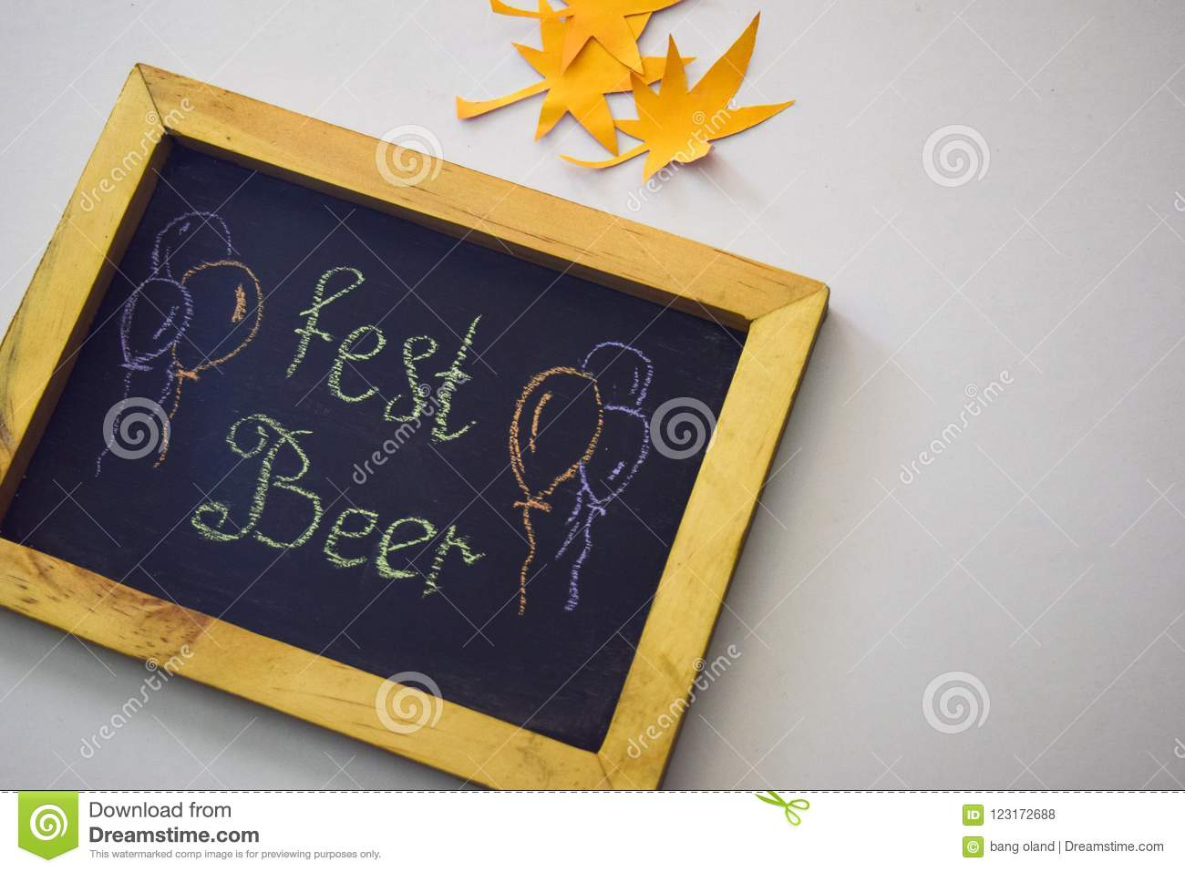 Celebrate october festival - clothes pins on grey/white background and a chalkboard with the slogan `Fest Beer`