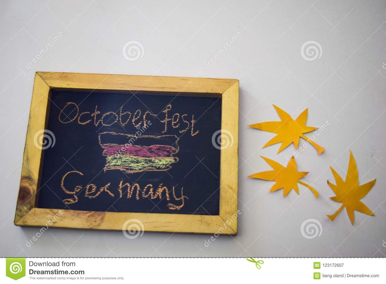 Celebrate october festival - clothes pins on grey/white background and a chalkboard with the slogan `October Fest Germany`