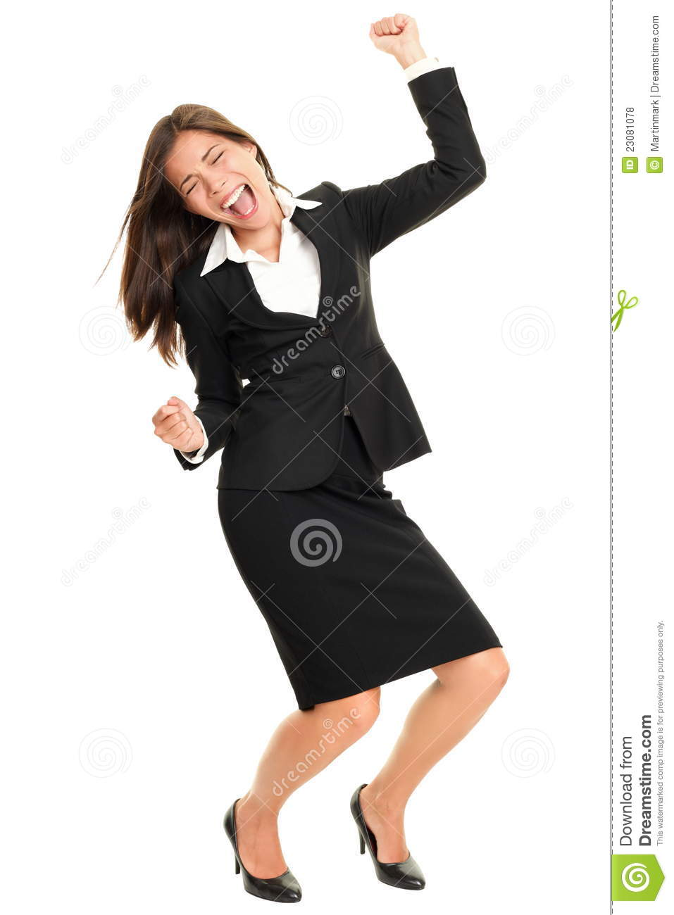 Celebrating business woman dancing happy and joyful cheering in suit ...