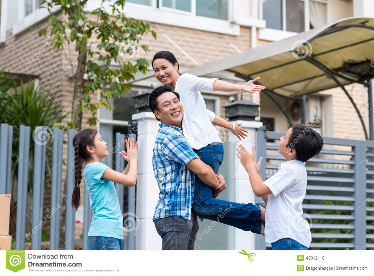 Celebrating Family Stock Photo - Image: 49012118 Happy Asian Family In Front Of House