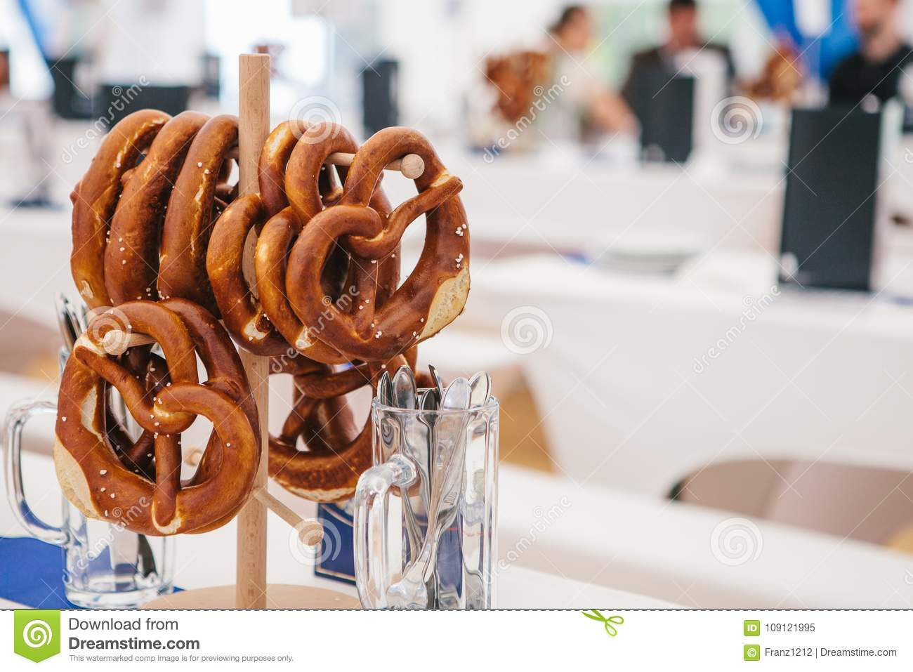 Celebration of the famous German beer festival Oktoberfest. Traditional pretzels called Brezel hang on the stand on the