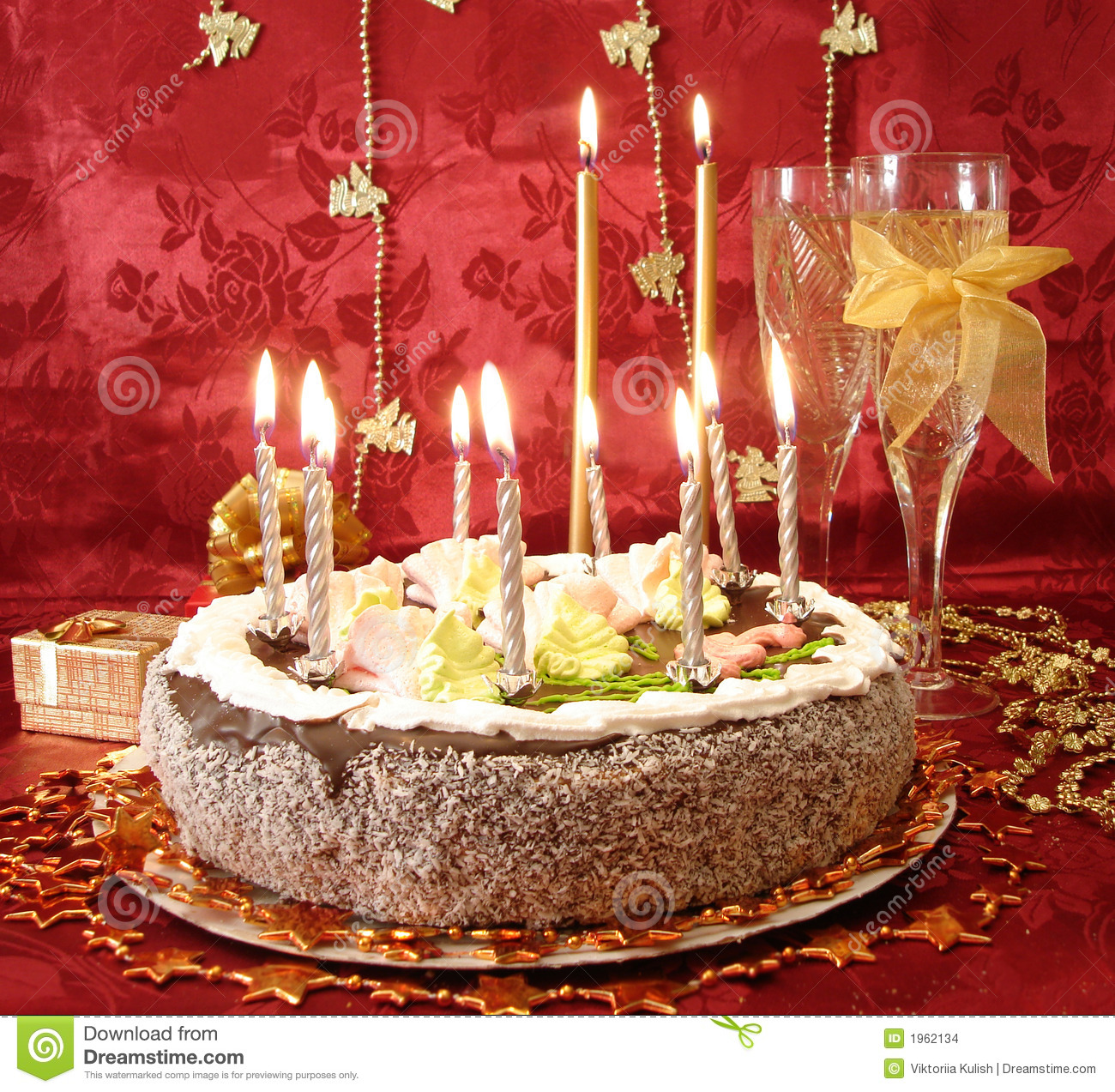 Celebratory Table Cake And Candles Two Glasses With