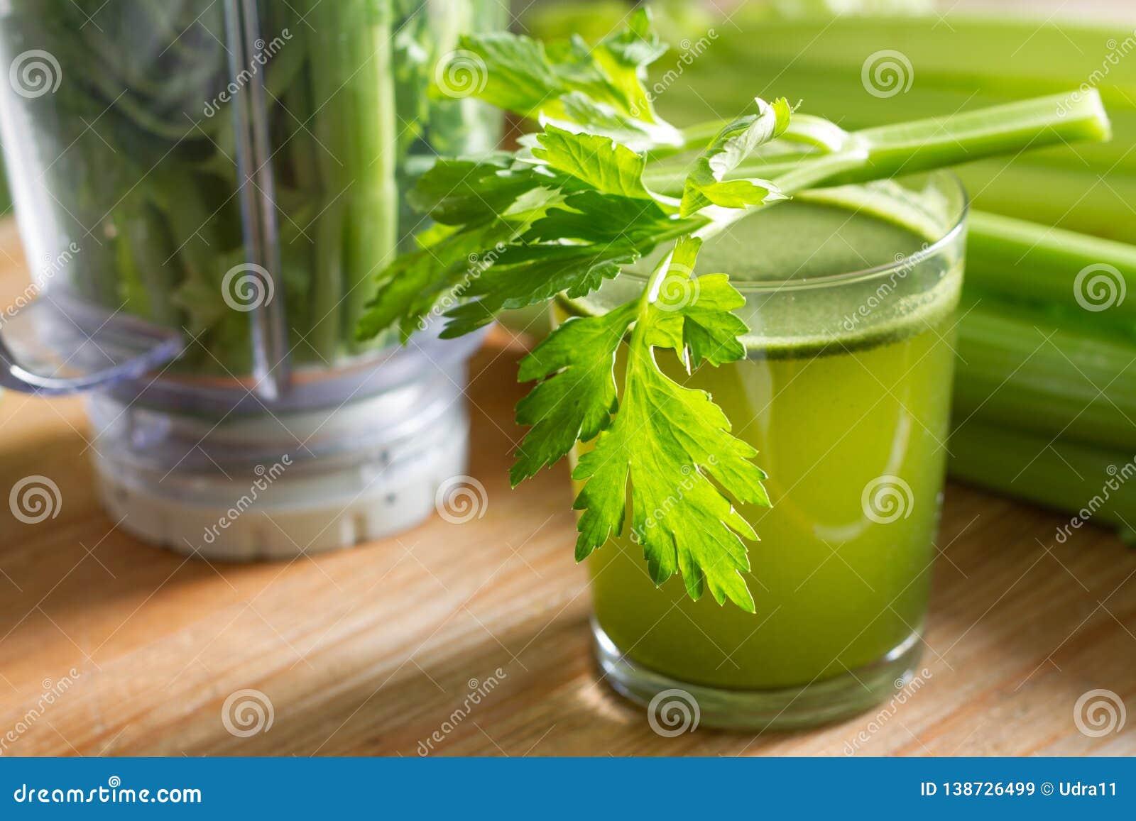 Celery juice healthy life stile and blender on wooden board