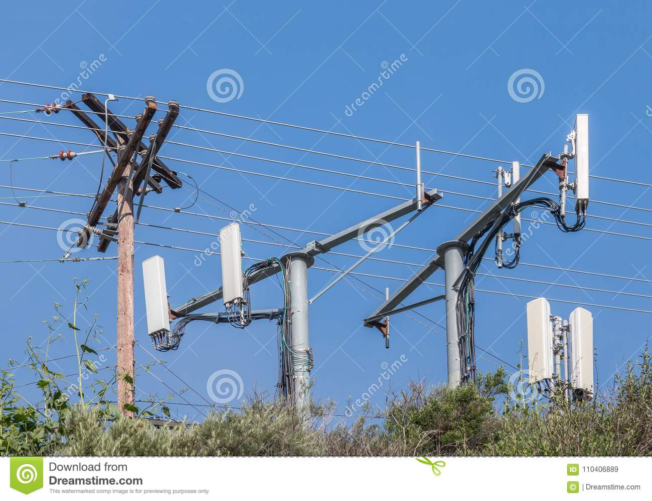 Cell Phone Monopole Towers And Power Pole  Stock Image