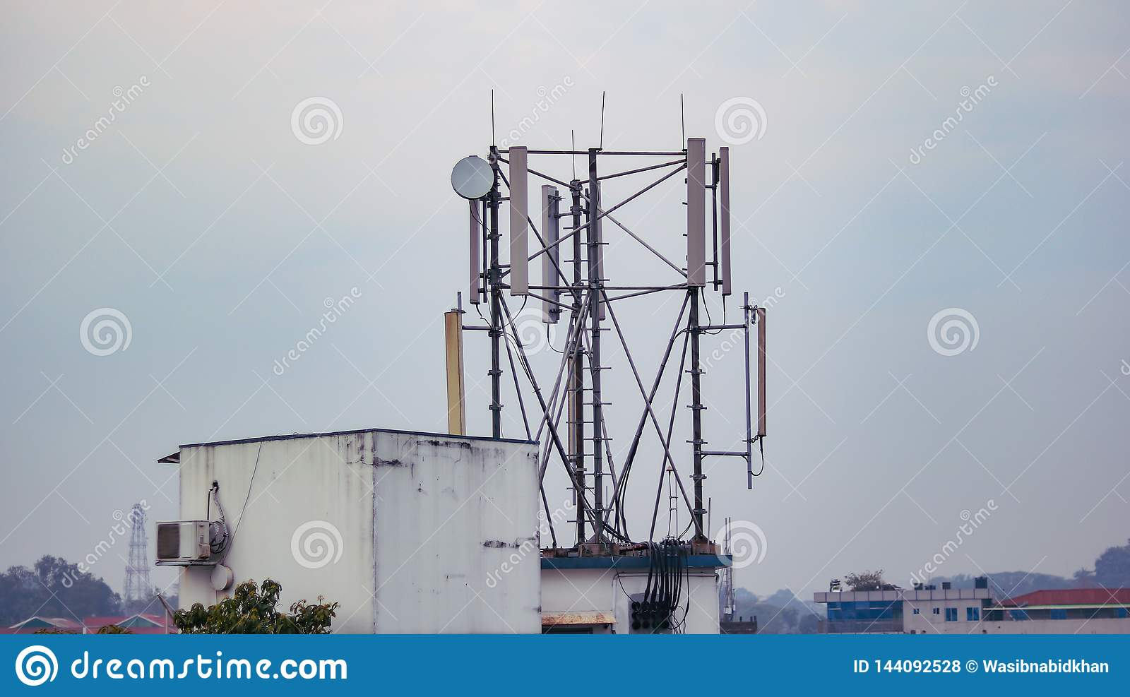 A cell phone network tower in daylight