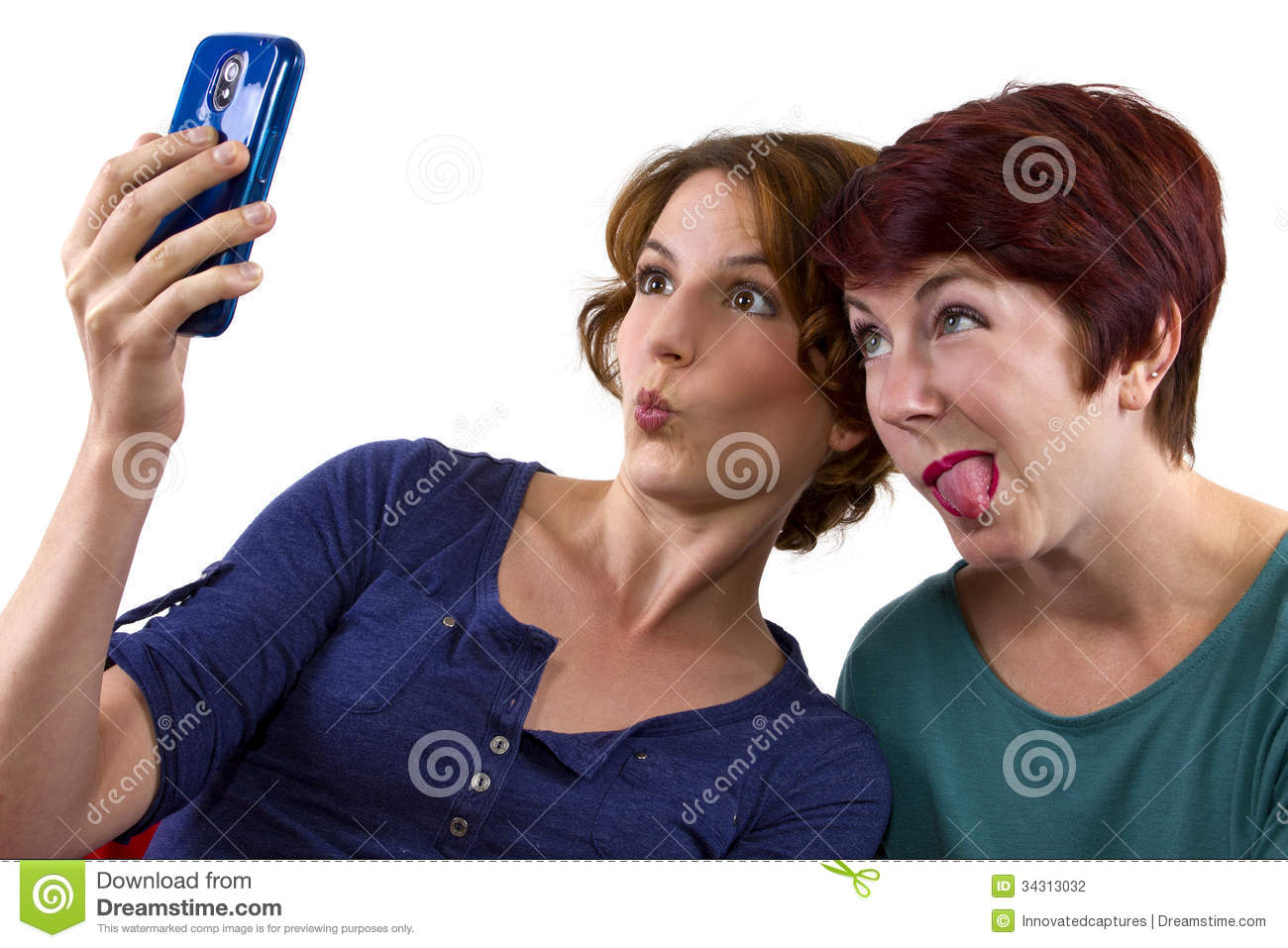 Two women taking self portraits with a cell phone.