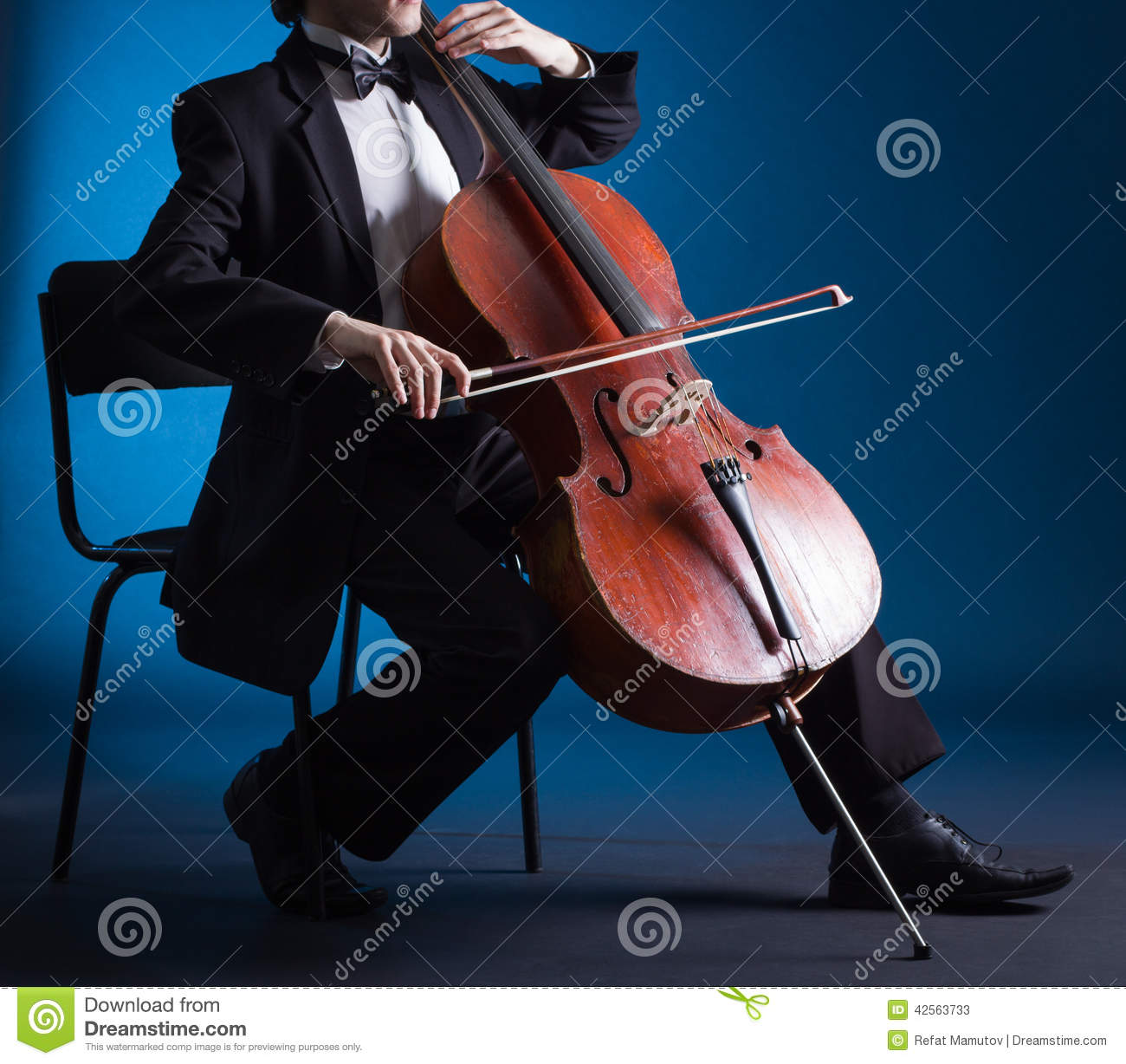 Cellist playing on cello