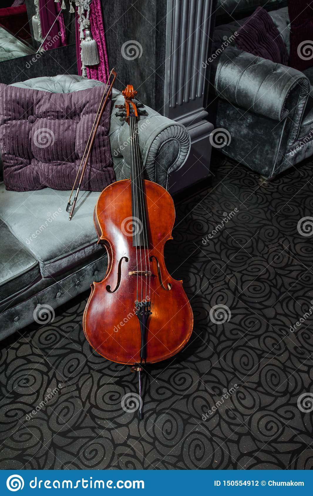 Cello on grey couch