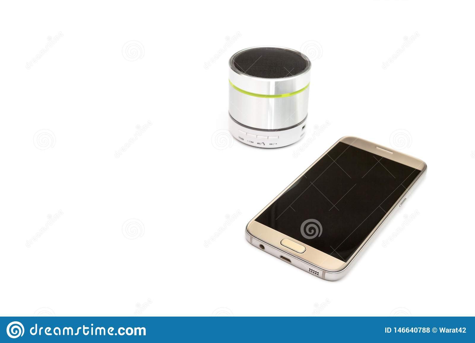 Cellphone and silver bluetooth speaker isolated on white background
