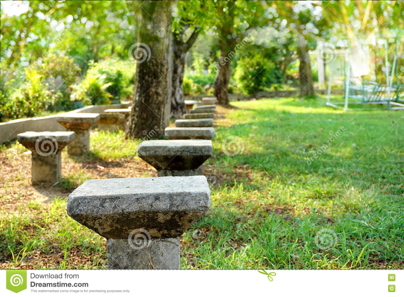 Cement Chair In A Park green Nature Playground Stock Image