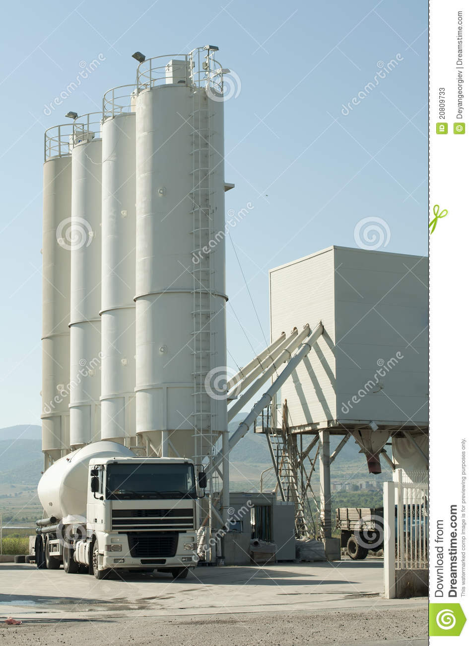 Cement Loading Plant : Cement factory and a truck loading stock photos