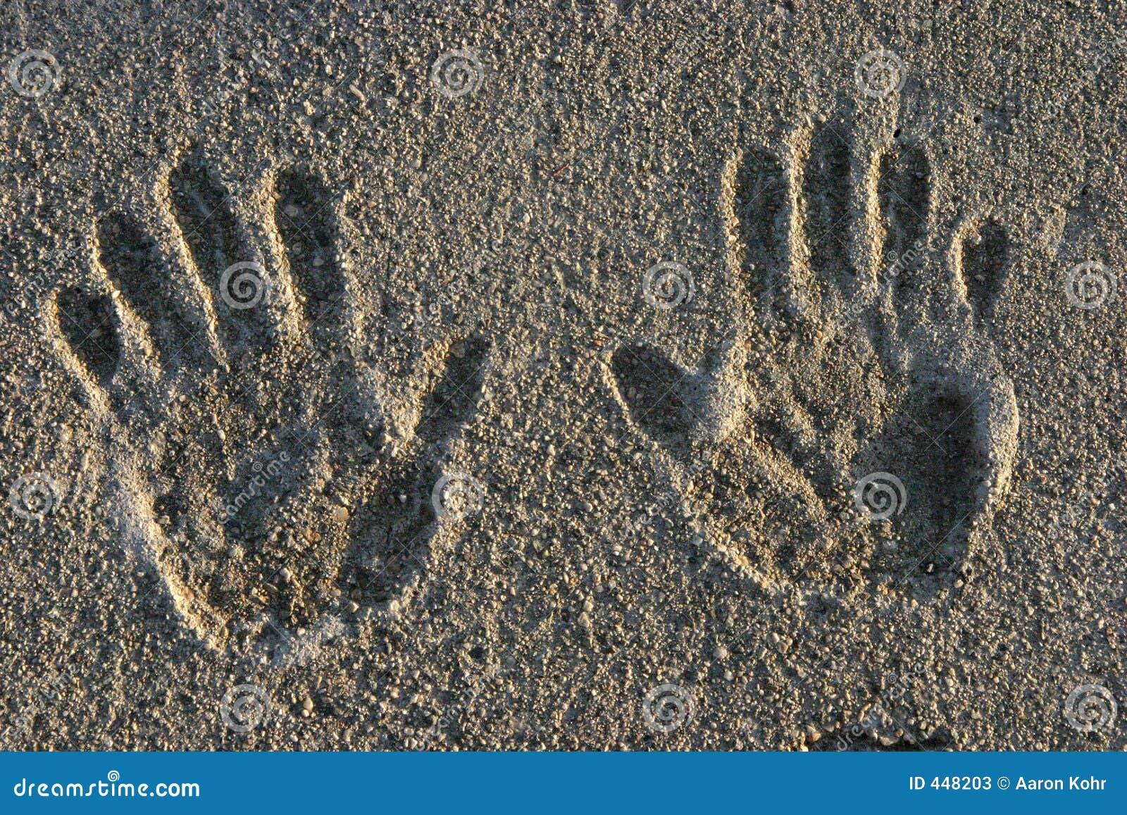cement hand prints stock photos