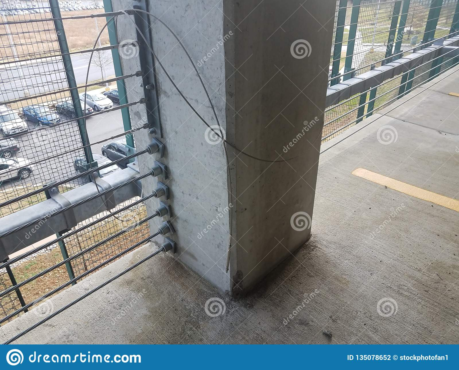 Cement Post In Parking Garage With Broken Wire Stock Photo - Image