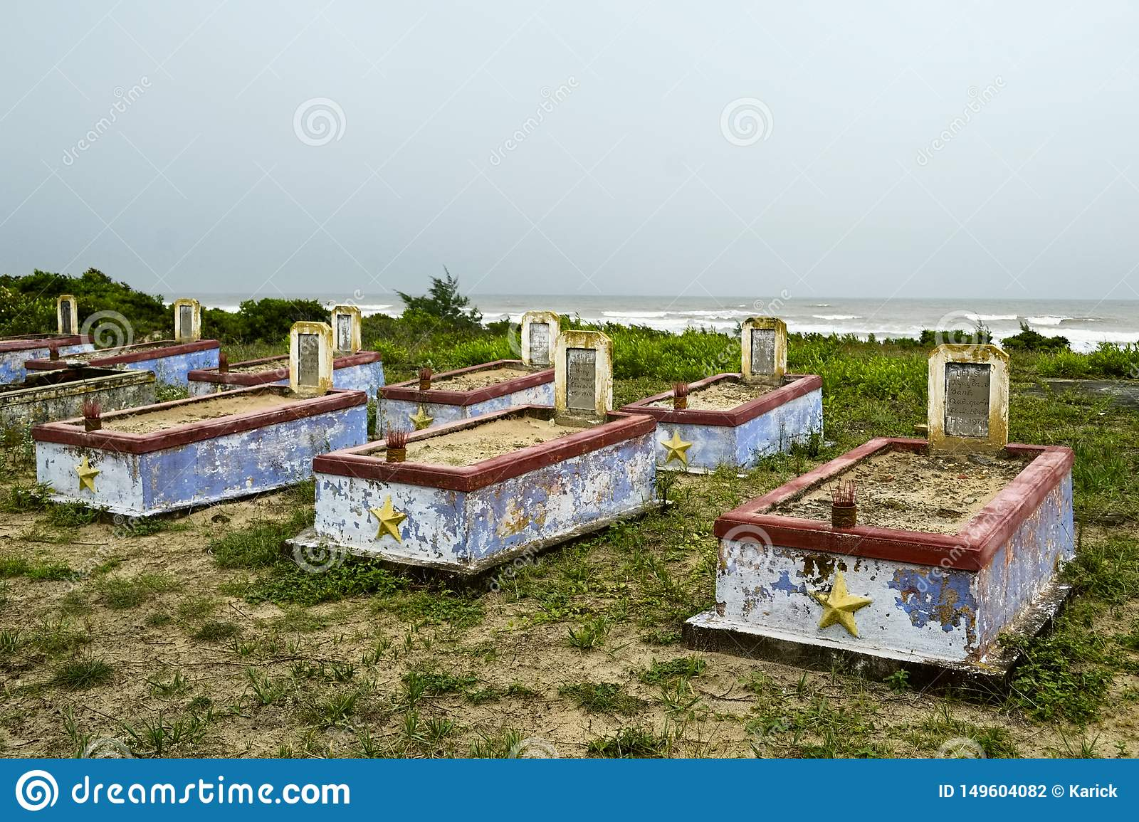 Cemetery of the Vietnam War with old weathered tombstones
