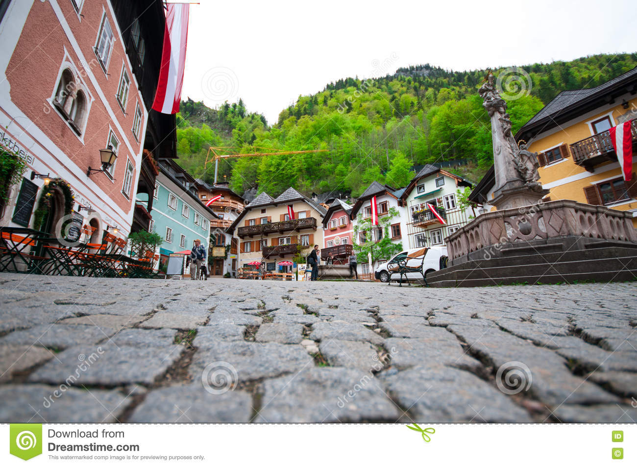Cenic picture-postcard view of the historic town square of Hallstatt with traditional colorful houses and church at Hallstatter Se