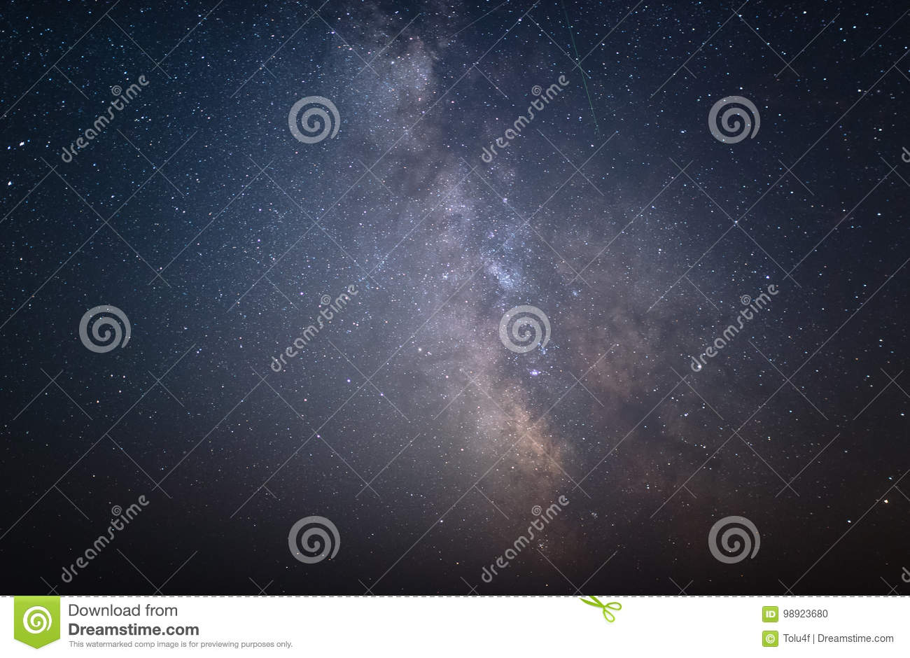 The center of our home galaxy and Andromeda galaxy, the Milky Way rising over the field