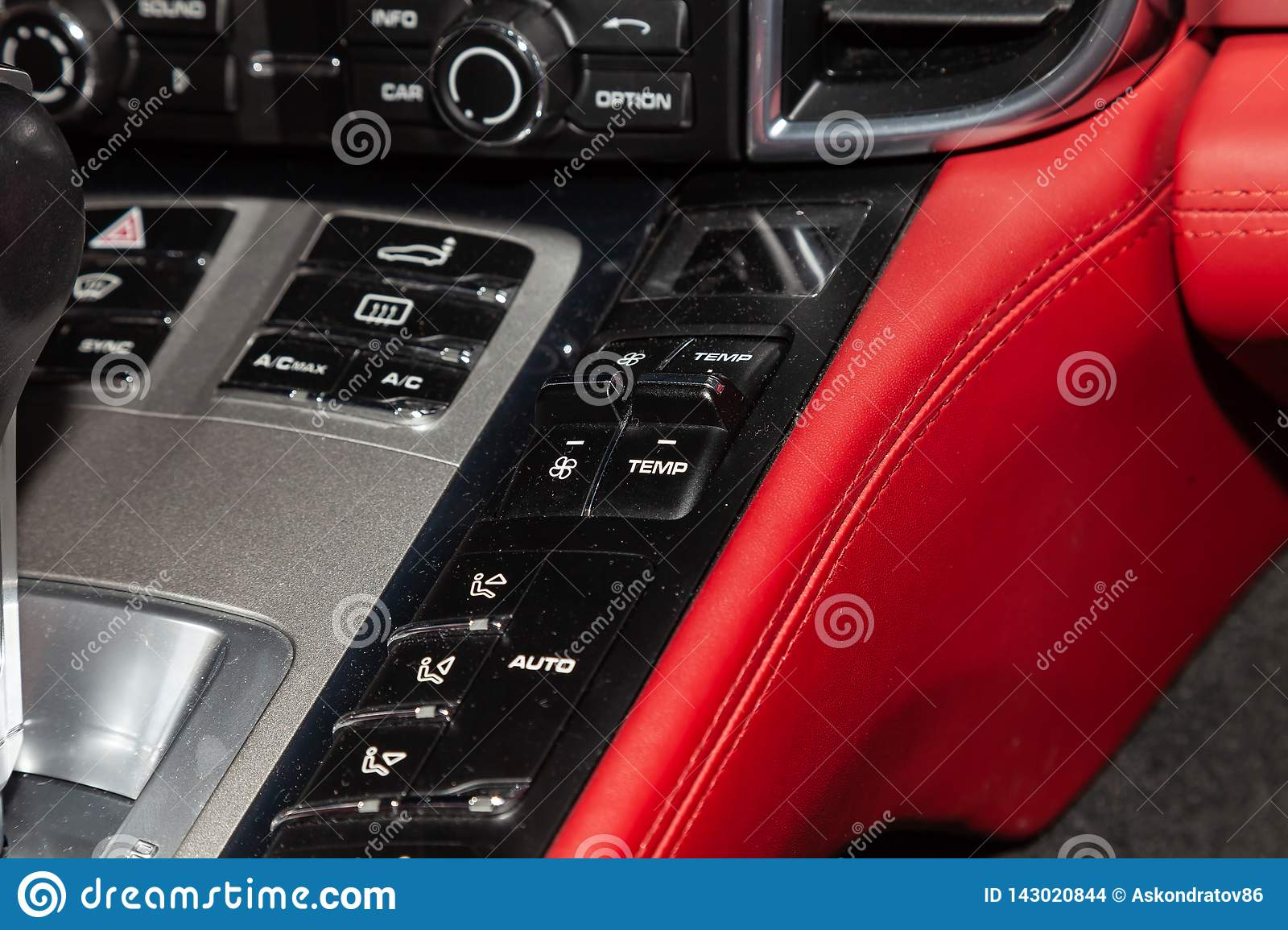 The central control console on the panel inside the car close-up with climate control and audio system and a hole for the CD and