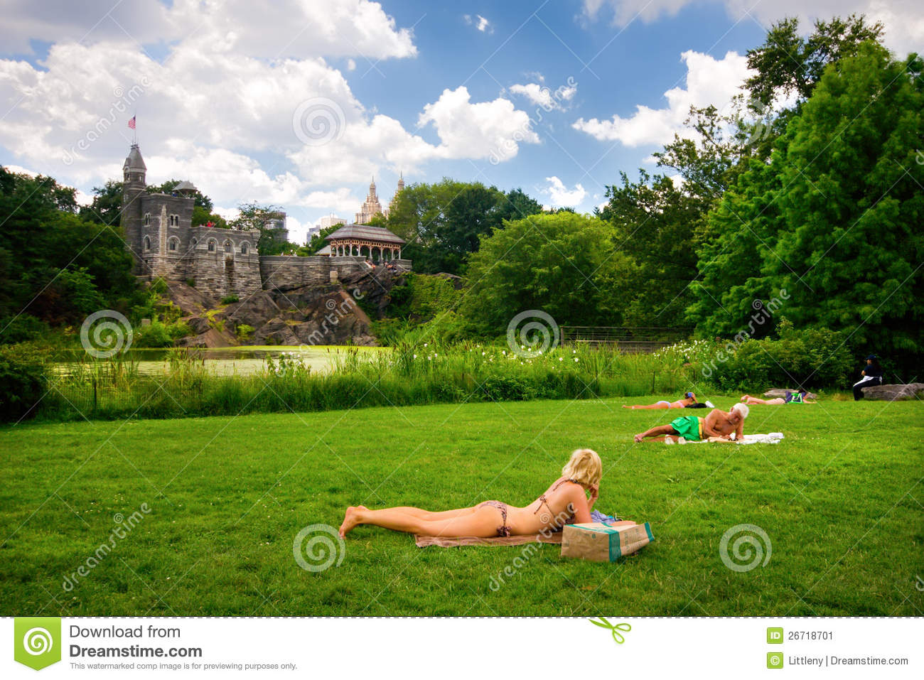 NEW YORK CITY, NY - JULY 24: Sunbathers on lawn in Central Park New ...