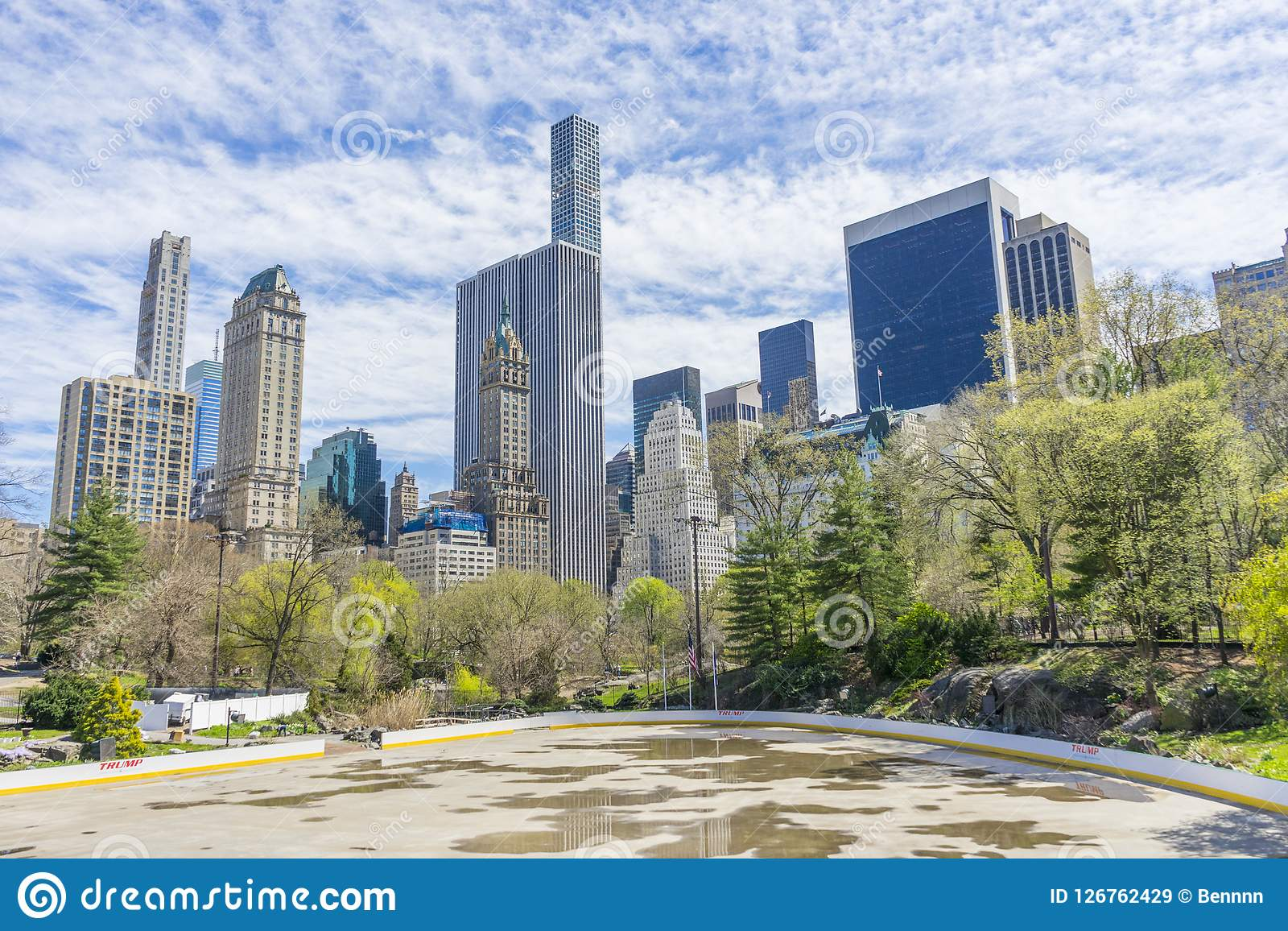 The Central Park in sunny day in New York,USA. The Central Park in sunny day with Manhattan skyscrapers in the background in New York,USA Royalty Free Stock Images
