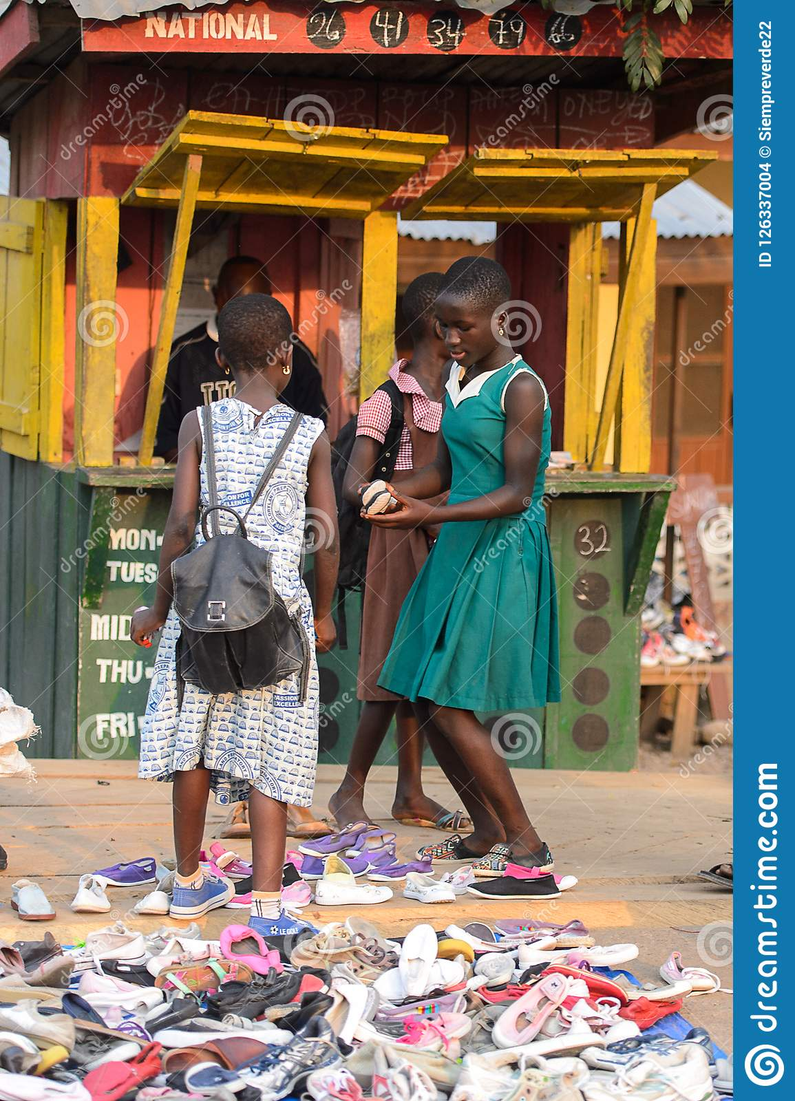 dd3f995c5adc Unidentified Ghanaian Girls Pick Up Shoes In Local Village. Peo ...