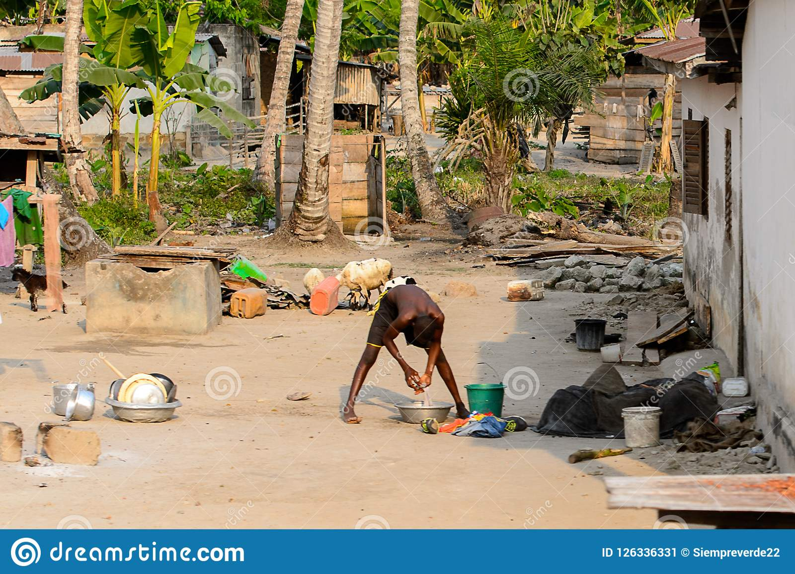 Unidentified Ghanaian man washes his hands in local village. Pe