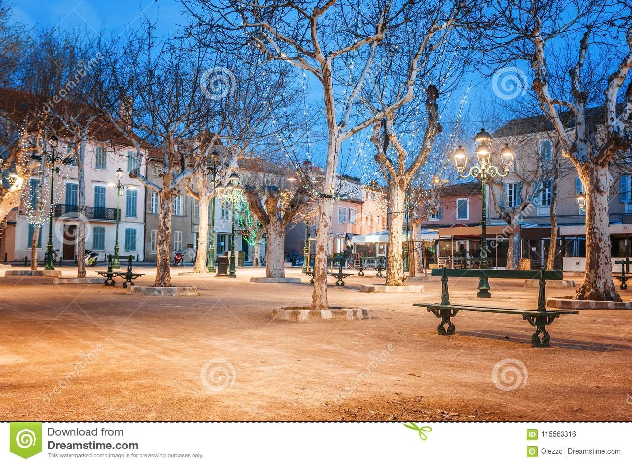 Central square in Saint-Tropez, France, city lights and night il
