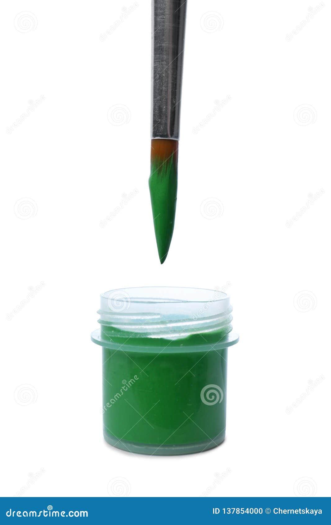 Cepillo y tarro plástico con la pintura en blanco