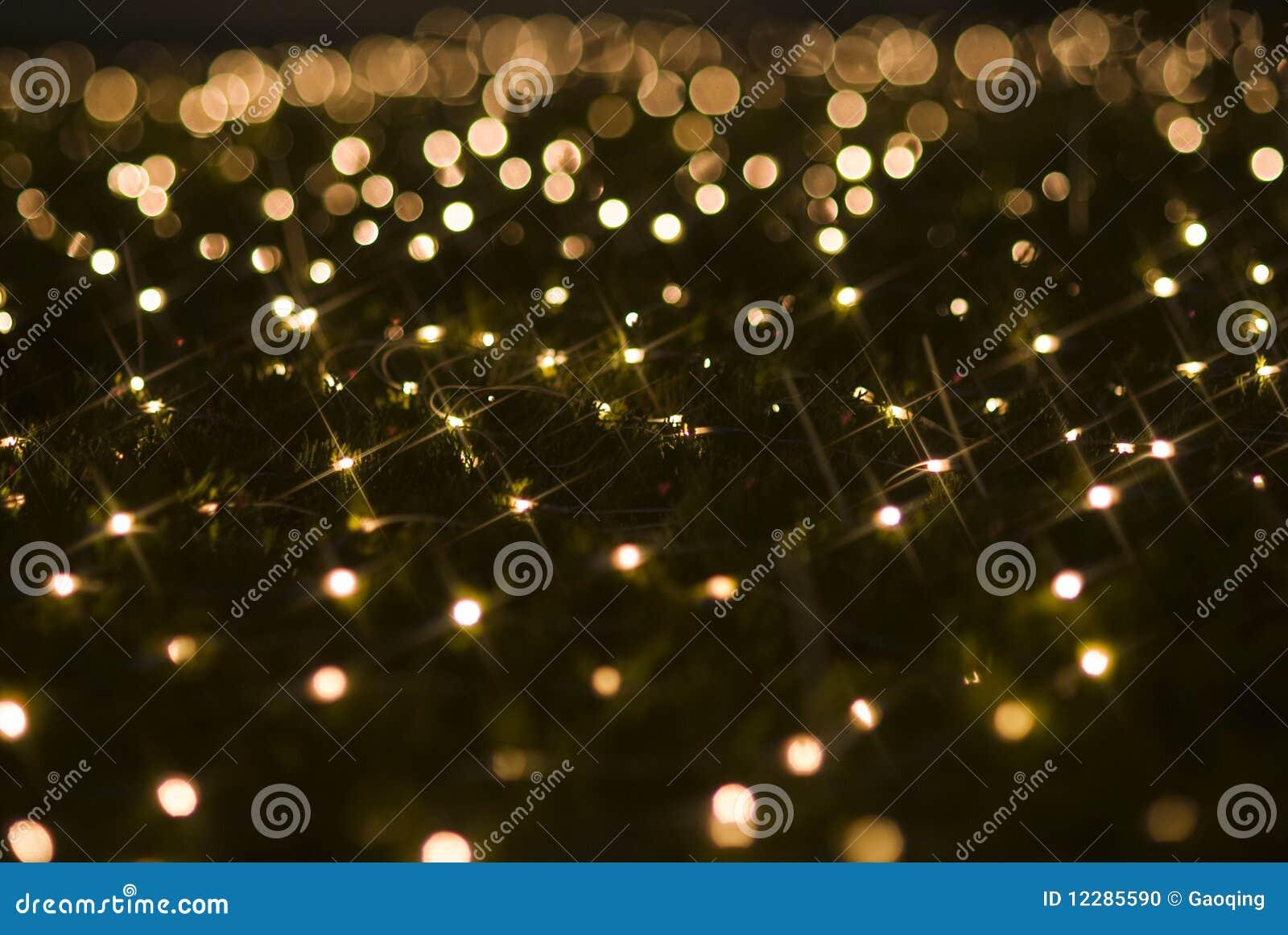 Cequis chispeantes de los efectos luminosos del día de fiesta de la Navidad