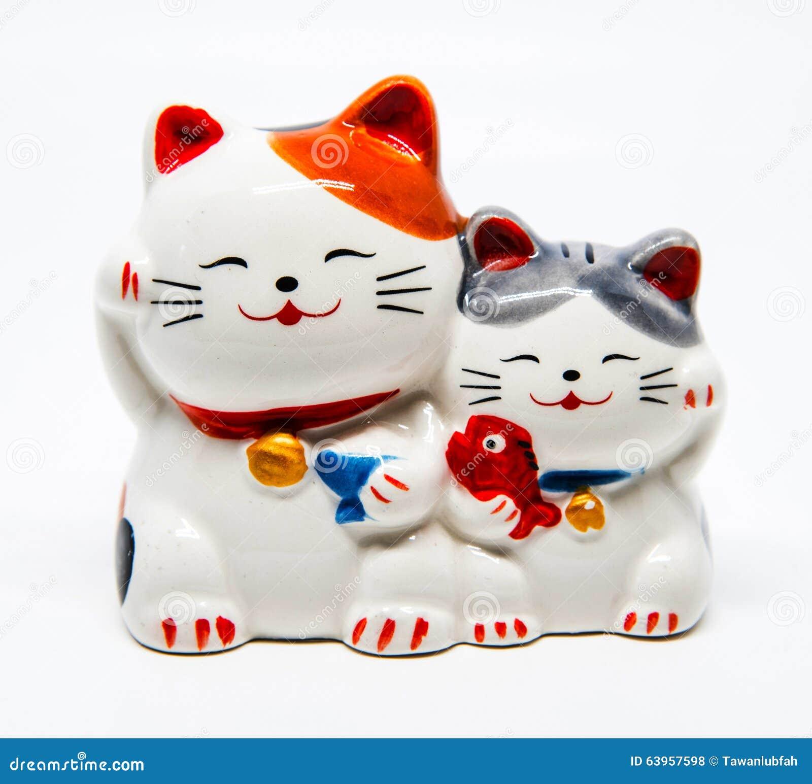 Ceramic Japanese welcoming Cats or lucky Cat ( Maneki Neko ).