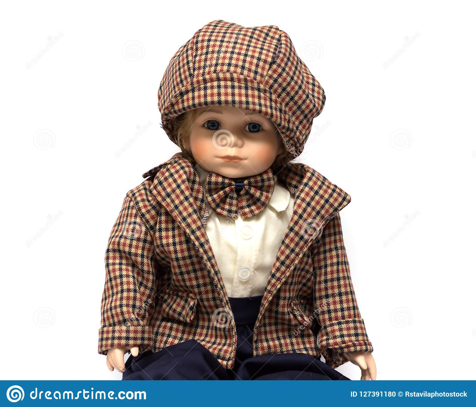 Ceramic porcelain handmade vintage doll of brunette boy with curly hair.