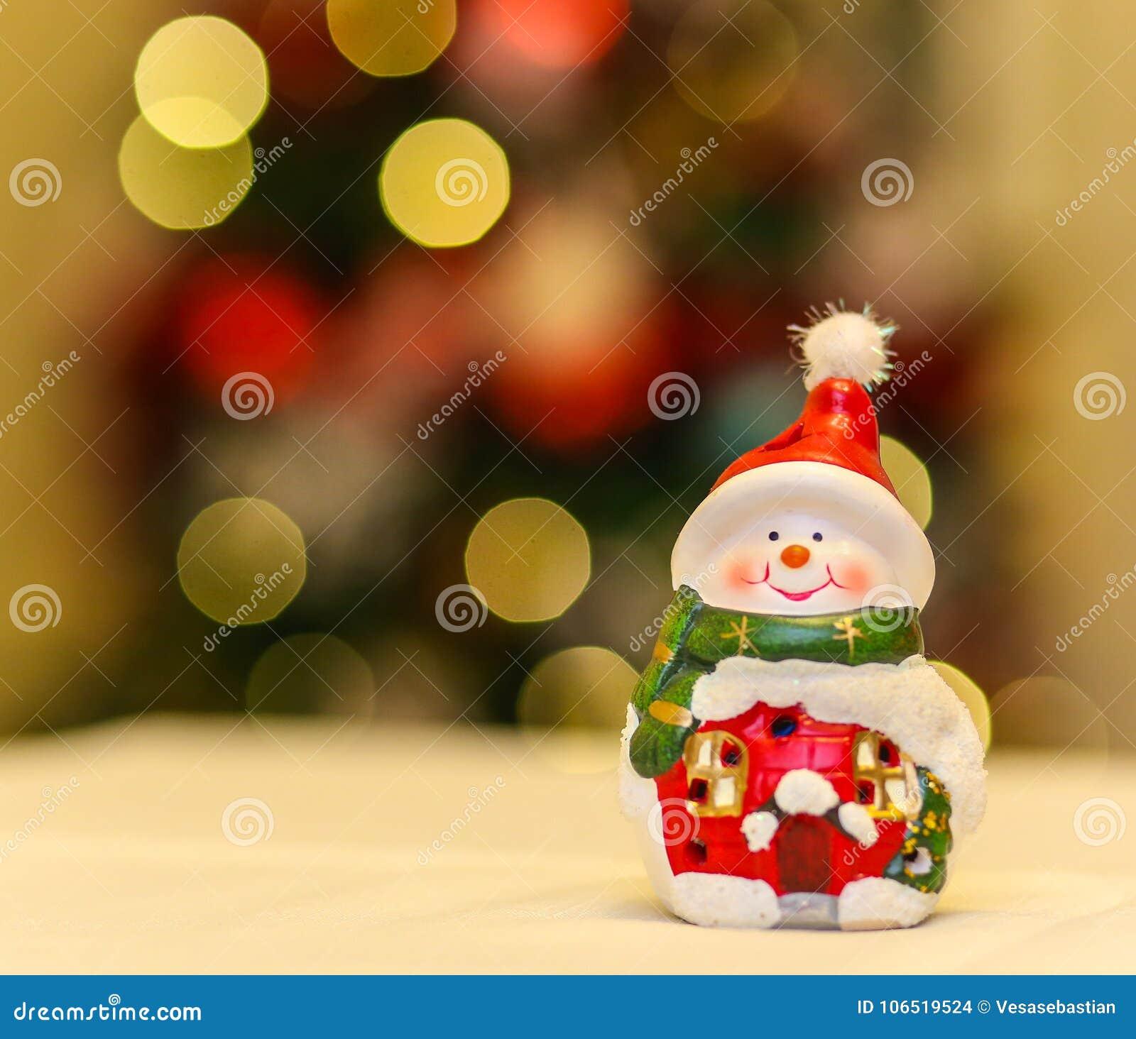 Ceramic Snowman Decoration With Christmas Tree Lights Stock Photo