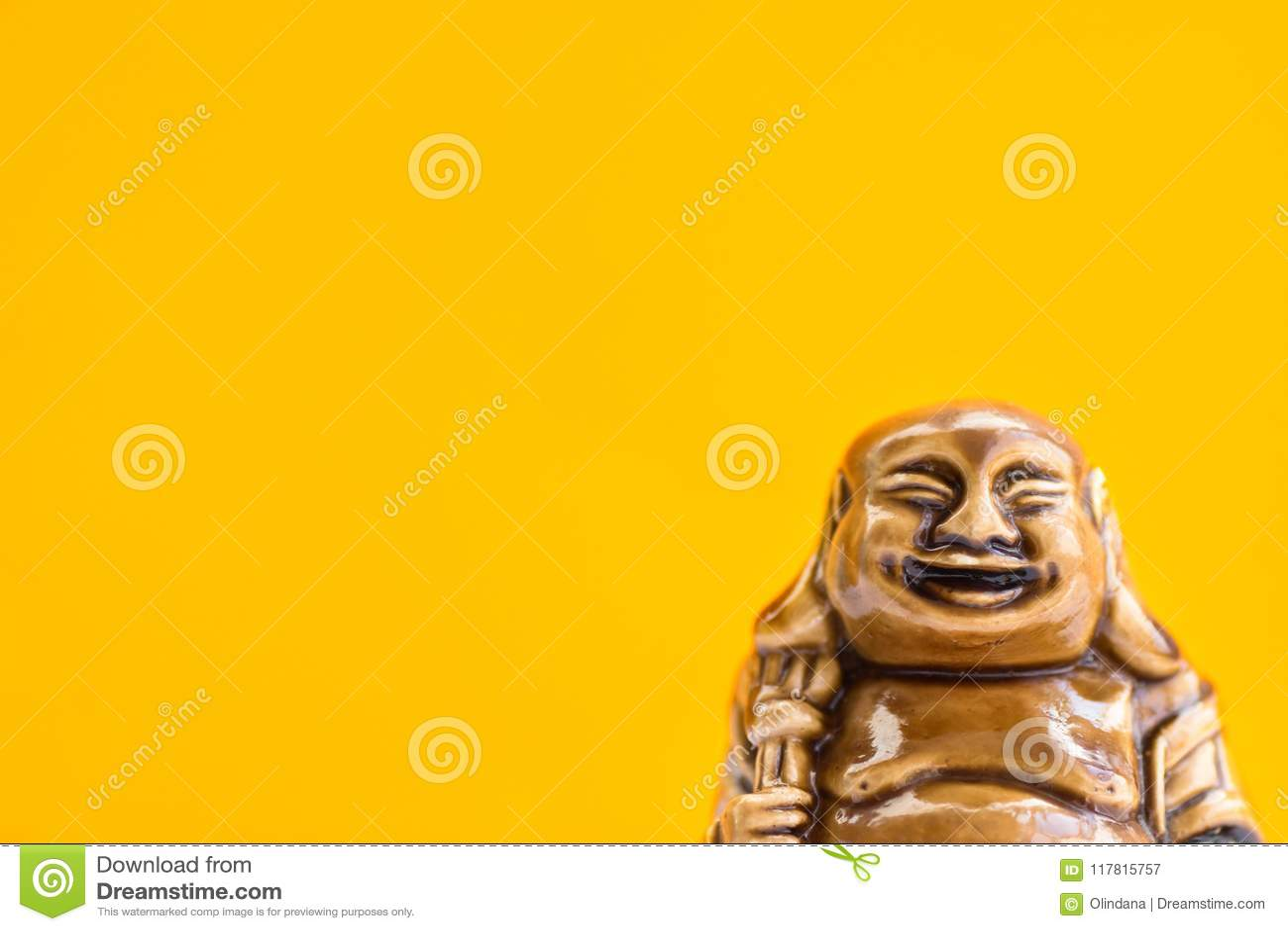 Ceramic Statue Of Laughing Buddha On Bright Orange Background