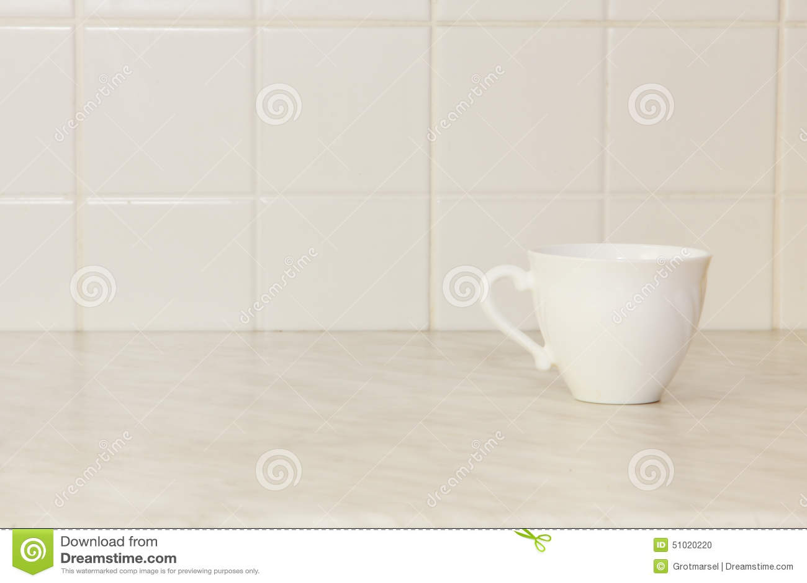 Ceramic Tea Cup On White Kitchen Table Stock Photo