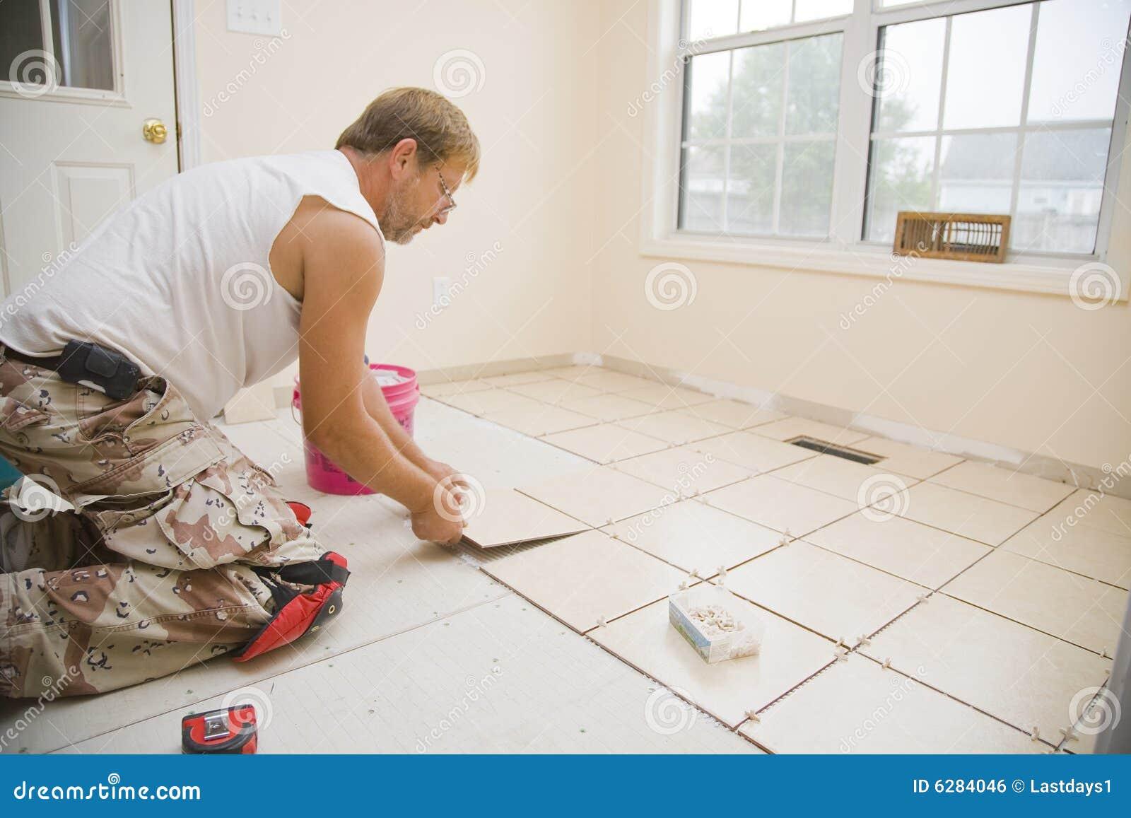 Ceramic tile installer stock photo image of straight 6284046 ceramic tile installer straight contractor dailygadgetfo Images