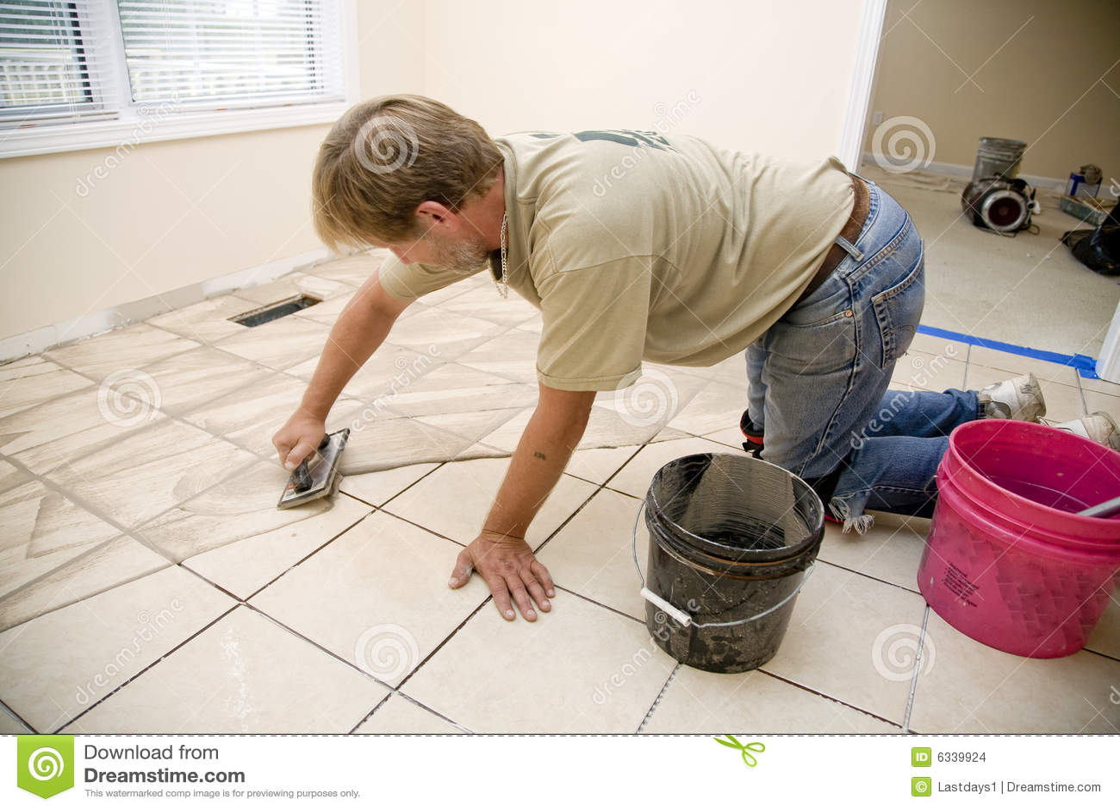 Ceramic tile installer stock photo image of expand ceramic 6339924 ceramic tile installer dailygadgetfo Images
