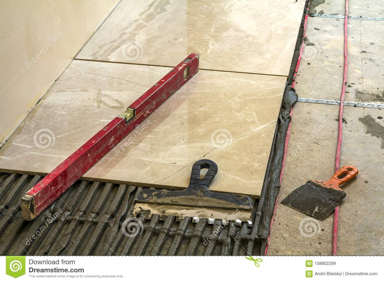 Ceramic tiles and tools for tiler floor tiles installation home royalty free stock photo dailygadgetfo Gallery