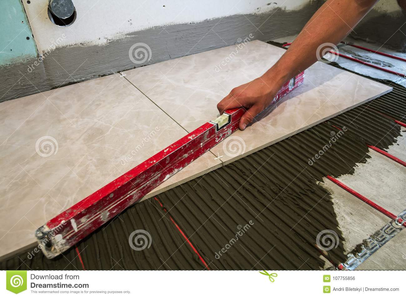 Ceramic tiles and tools for tiler worker hand installing floor ceramic tiles and tools for tiler worker hand installing floor mason black royalty free stock photo download ceramic tiles and tools dailygadgetfo Image collections