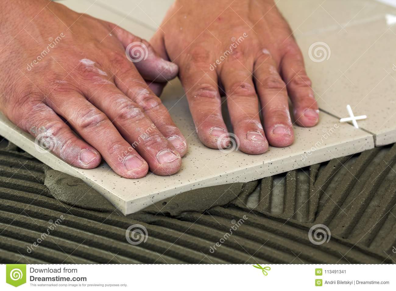 Ceramic tiles and tools for tiler worker hand installing floor royalty free stock photo dailygadgetfo Image collections