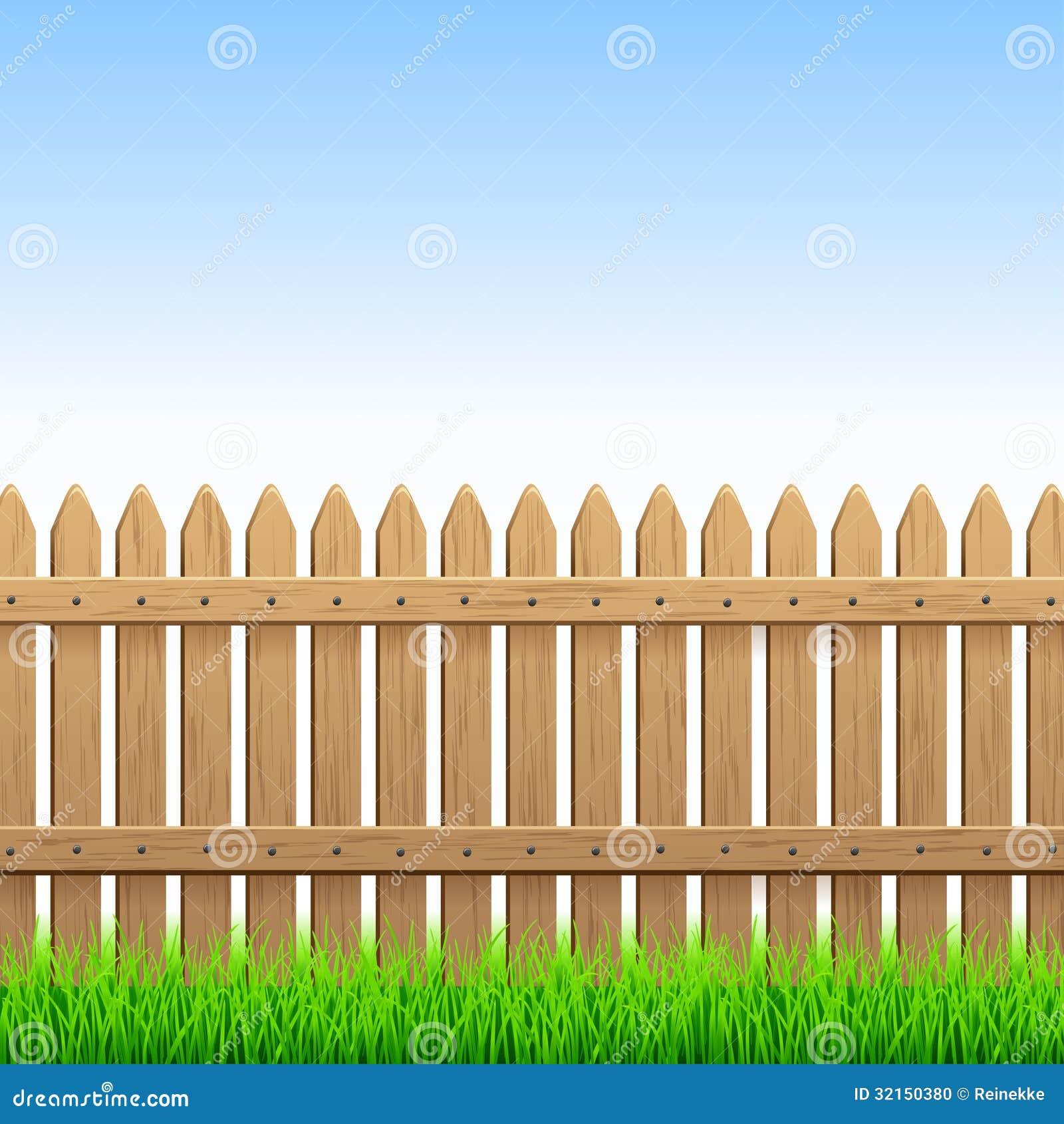Ejemplo de la cerca de madera del país y de la hierba verde