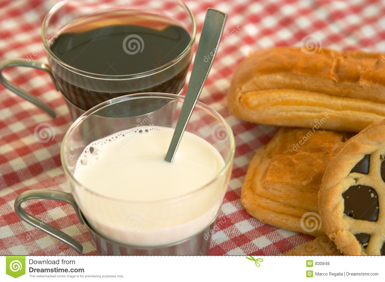 Cereal biscuits, chocolate cake, and a cup of milk