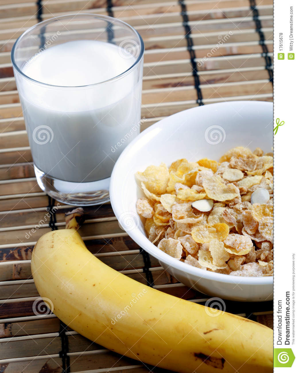 Cereal In Bowl With Milk And Banana Stock Photo