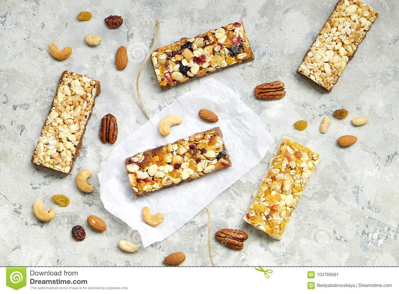 Cereal granola bars with nuts and dry berries on a white background download cereal granola bars with nuts and dry berries on a white background top view ccuart Image collections