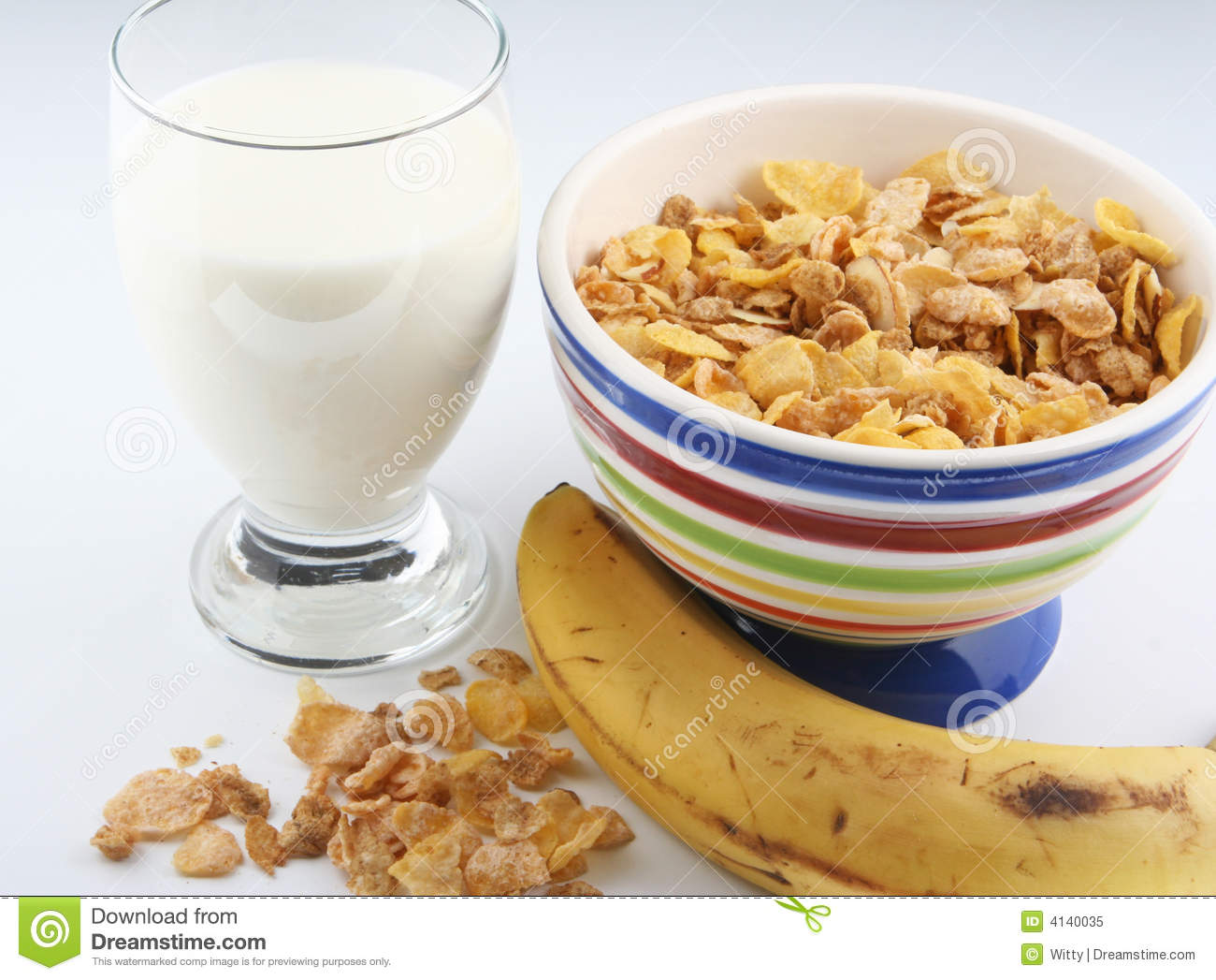Breakfast of cereal, milk, and banana.