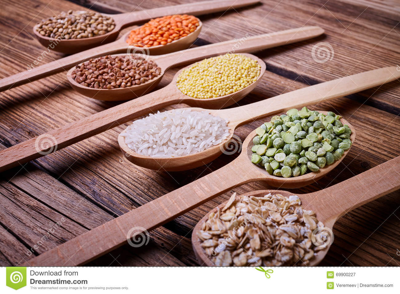 Cereals in wooden spoons stock image of barley