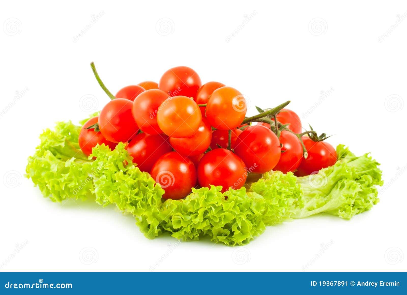 Cereja dos tomates e salada verde