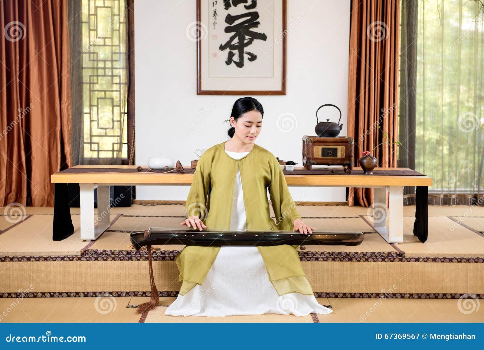 Cerimônia de chá de desempenho-China da cítara