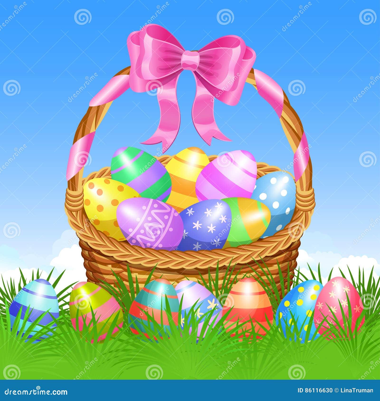 Cesta de Pascua y huevos de Pascua coloridos en la hierba verde para Pascua